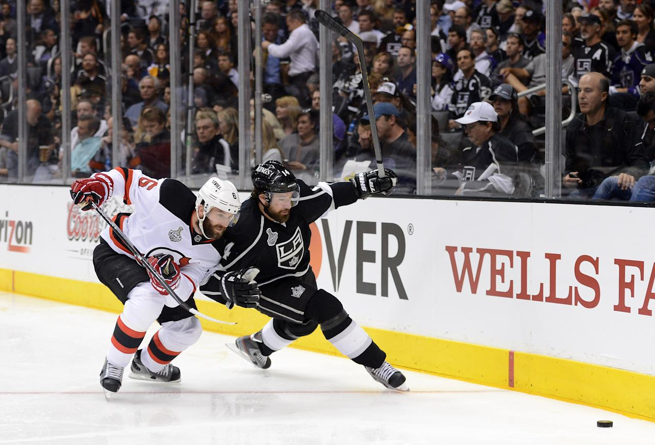 LOS ANGELES, CA - JUNE 04:  Andy Greene #6 of the New Jersey Devils and Justin Williams #14 of the Los Angeles Kings vie for the puck near the end boards in Game Three of the 2012 Stanley Cup Final at Staples Center on June 4, 2012 in Los Angeles, California.  (Photo by Harry How/Getty Images)