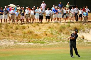 Phil Mickelson hits an approach shot on the fourth hole during the first round of the 114th U.S. Open. (Getty Images)