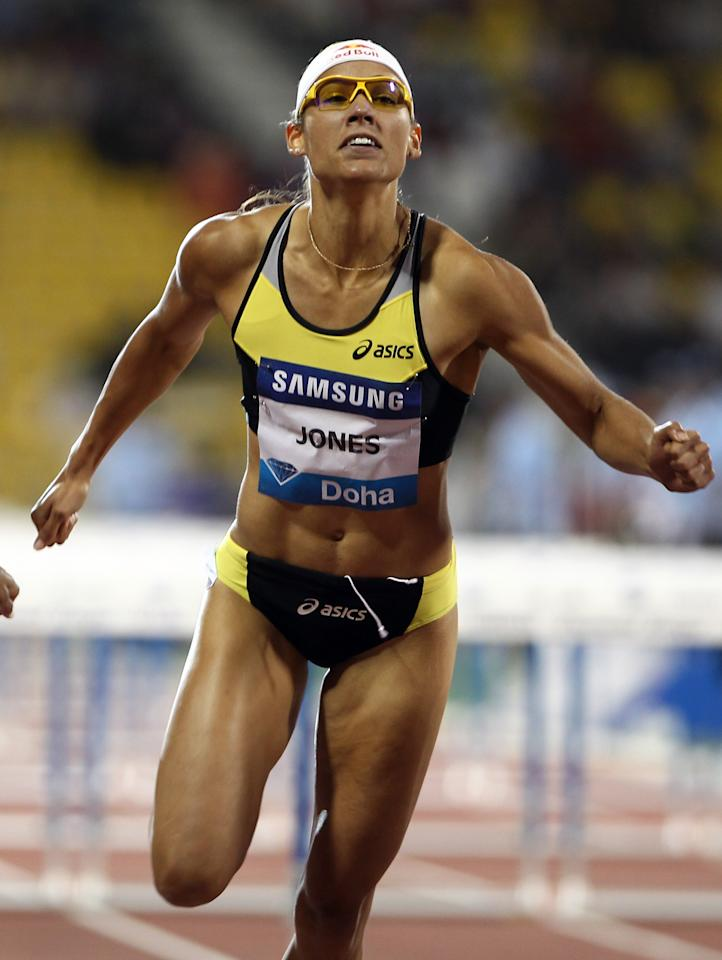 Lolo Jones of the US competes in the women's 100m hurdles at the IAAF Diamond League in Doha on May 6, 2011.