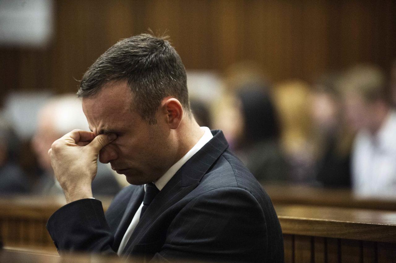 South African Olympic and Paralympic athlete Oscar Pistorius reacts during his murder trial in the North Gauteng High Court in Pretoria, April 16, 2014. Pistorius is on trial for murdering his girlfriend Reeva Steenkamp at his suburban Pretoria home on Valentine's Day last year. REUTERS/Gianluigi Guercia/Pool (SOUTH AFRICA - Tags: SPORT CRIME LAW TPX IMAGES OF THE DAY ATHLETICS)