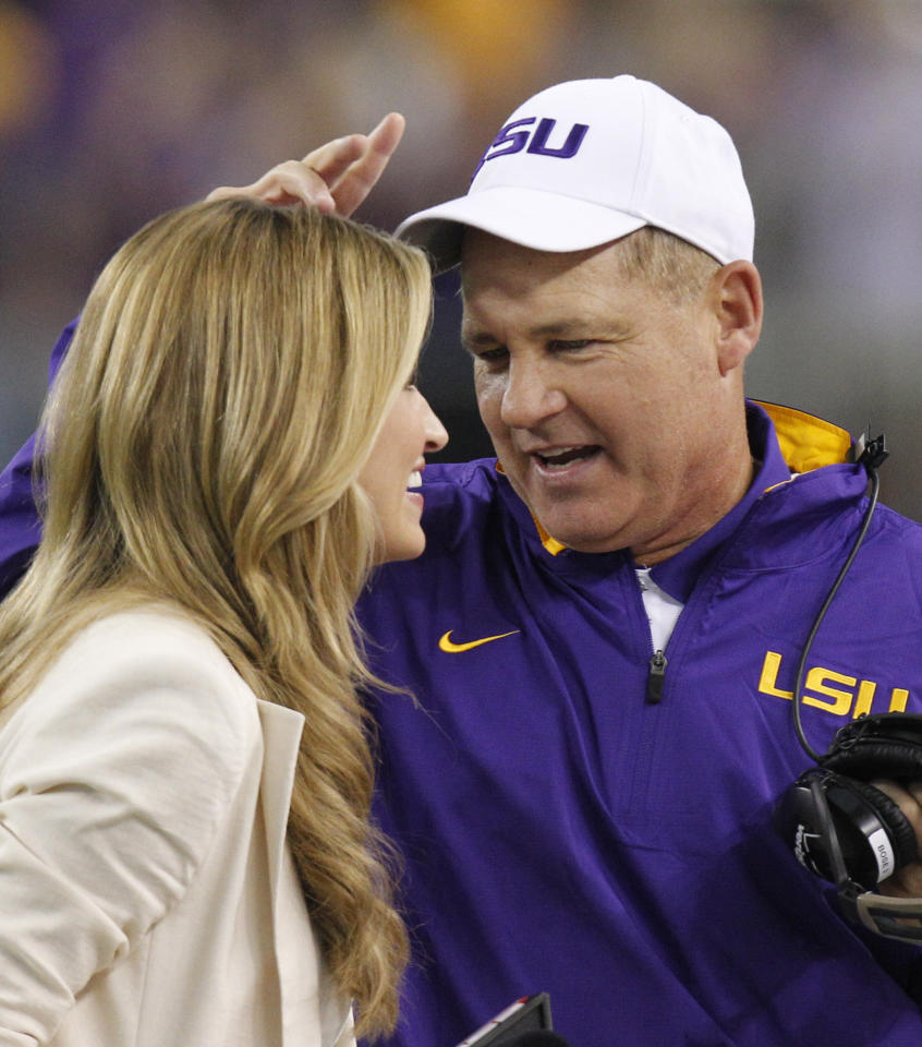 LSU head coach Les Miles, right, talks with ESPN reporter Erin Andrews during the first half of the Cowboys Classic NCAA college football game agianst Oregon, Saturday, Sept. 3, 2011, in Arlington, Texas. (AP Photo/LM Otero)