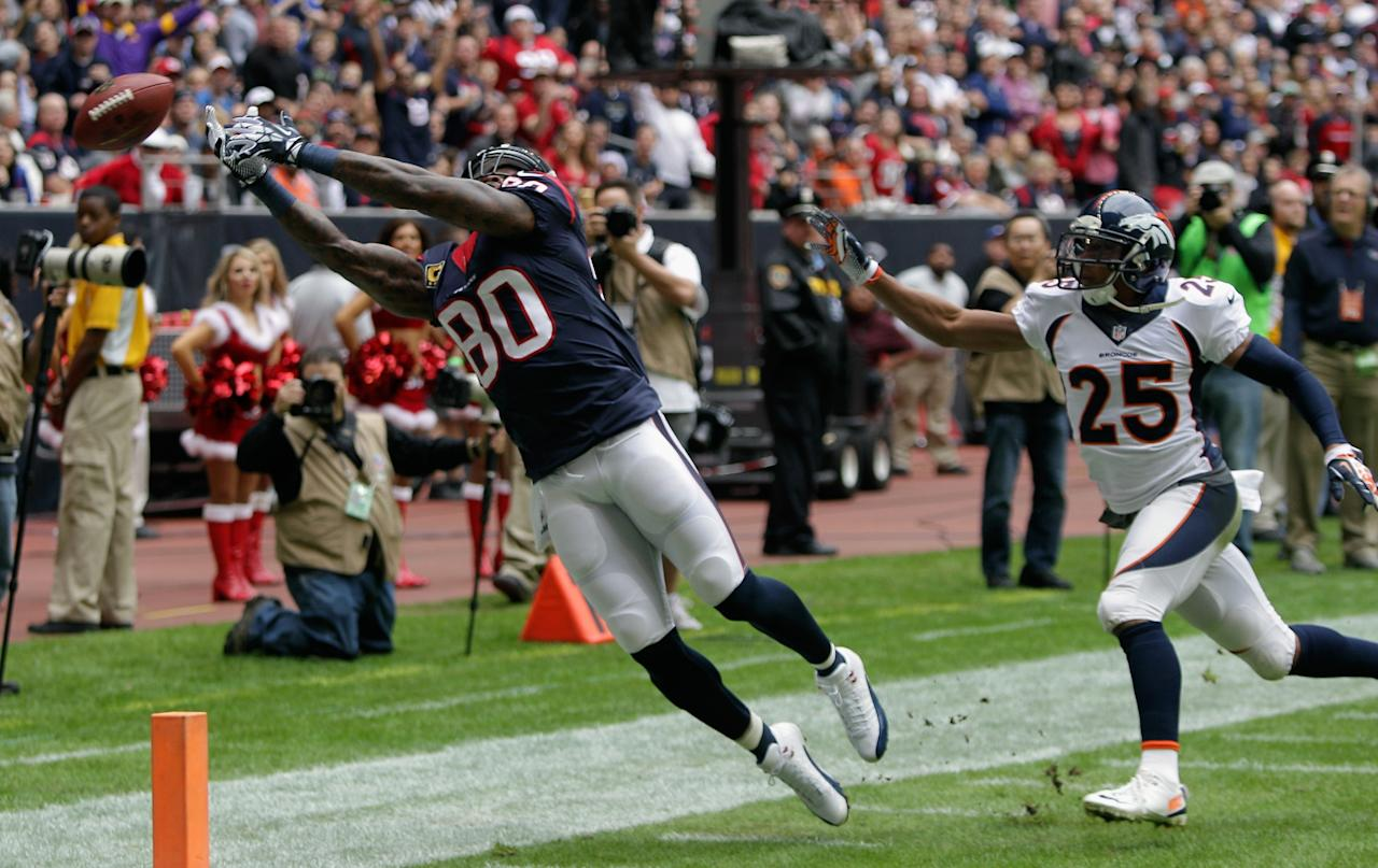 HOUSTON, TX - DECEMBER 22: Andre Johnson #80 of the Houston Texans has the ball go off his fingertips as Chris Harris #25 of the Denver Broncos defends at Reliant Stadium on December 22, 2013 in Houston, Texas. (Photo by Bob Levey/Getty Images)