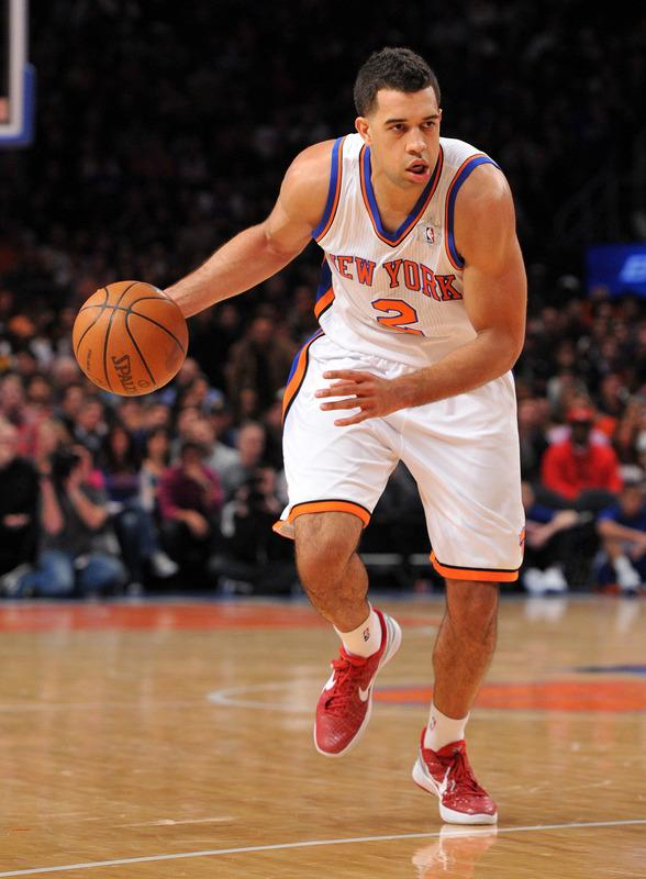 NEW YORK, NY - DECEMBER 25: Landry Fields #2 of the New York Knicks controls the ball during the second half against the Boston Celtics at Madison Square Garden on December 25, 2011 in New York City. NOTE TO USER: User expressly acknowledges and agrees that, by downloading and or using this photograph, User is consenting to the terms and conditions of the Getty Images License Agreement. (Photo by Christopher Pasatieri/Getty Images)