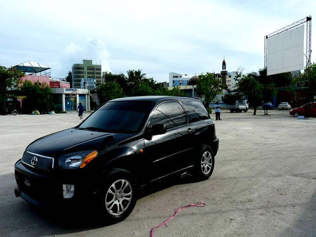 A Toyota RAV4 2-door passenger vehicle is seen outside an outdoor concert venue in Male. There are 23 motor vehicles per thousand people in the Maldives, most of them concentrated in the capital. The high import duty on passenger motor vehicles is intended as a deterrent but the streets are crowded with cars and two-wheelers, while the ocean is studded with boats.