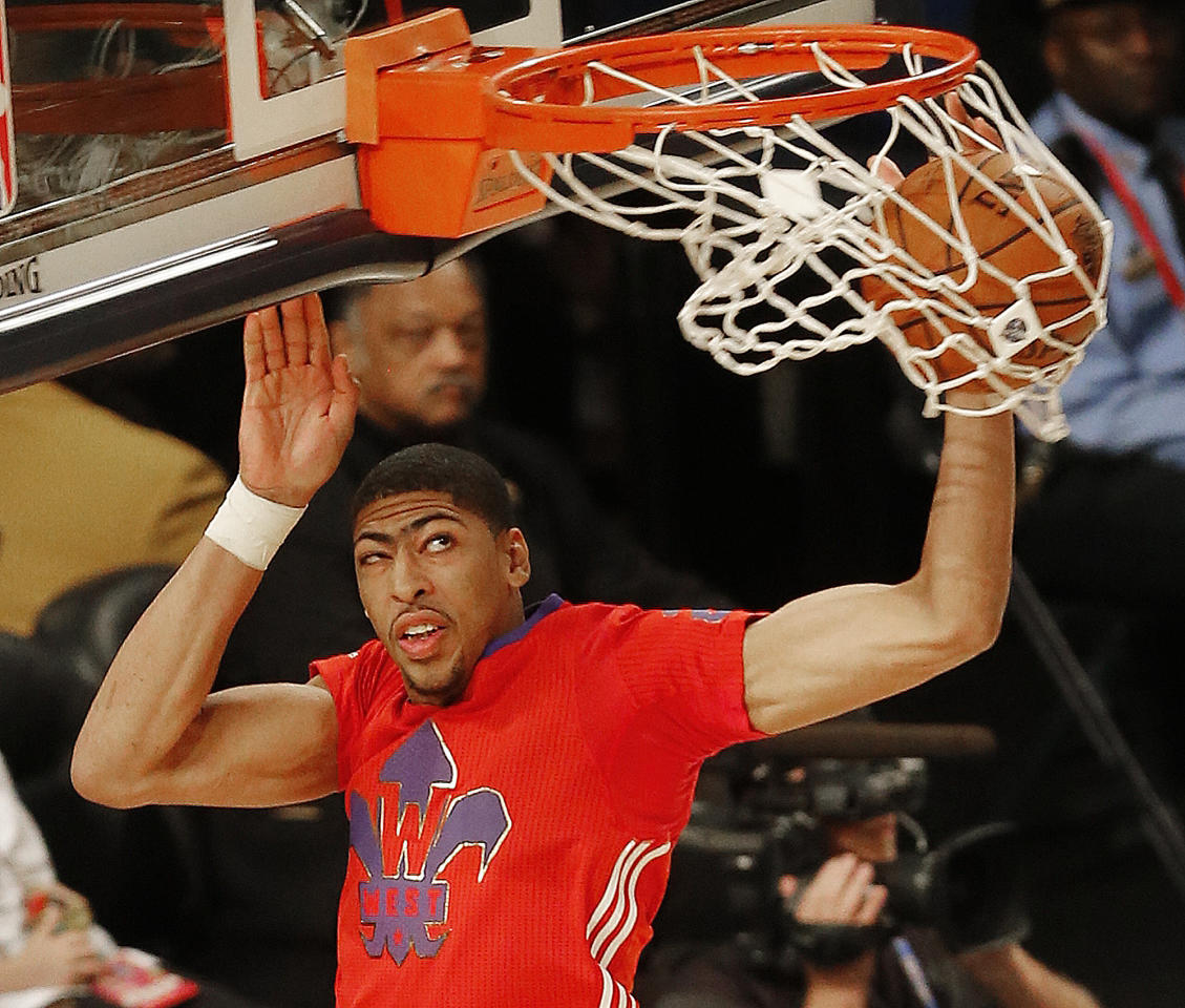 West Team's Anthony Davis, of the New Orleans Pelicans (23) dunks the ball against the West Team during the NBA All Star basketball game, Sunday, Feb. 16, 2014, in New Orleans. (AP Photo/Bill Haber)