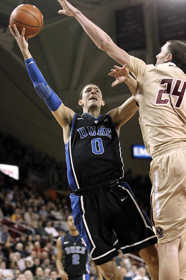 Duke guard Austin Rivers shoots past Boston College center Dennis Clifford during the second half of Duke's 75-50 win in an NCAA college basketball game in Boston, Sunday, Feb. 19, 2012. (AP Photo/Winslow Townson)