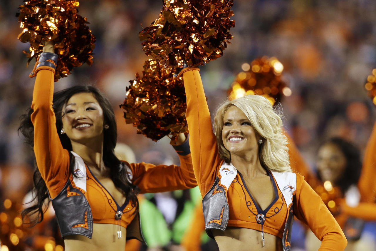 Denver Broncos cheerleaders perform before the NFL Super Bowl XLVIII football game against the Seattle Seahawks Sunday, Feb. 2, 2014, in East Rutherford, N.J. (AP Photo/Mark Humphrey)
