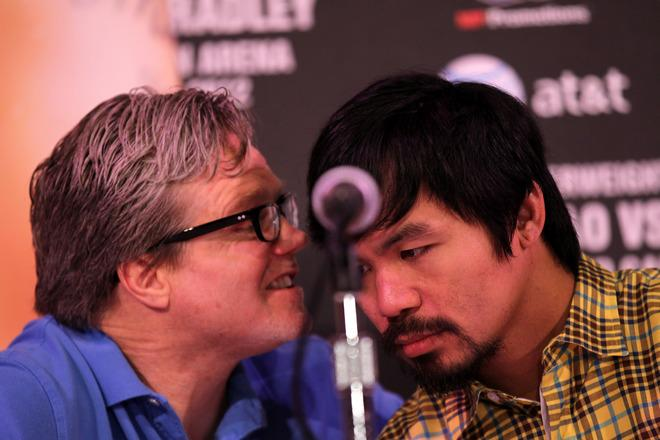 BEVERLY HILLS, CA - FEBRUARY 21:  Trainer Freddie Roach talks with Manny Pacquiao at a press conference announcing Pacquiao's upcoming World Boxing Organization welterweight championship fight against Timothy Bradley at The Beverly Hills Hotel on February 21, 2012 in Beverly Hills, California.  (Photo by Stephen Dunn/Getty Images)