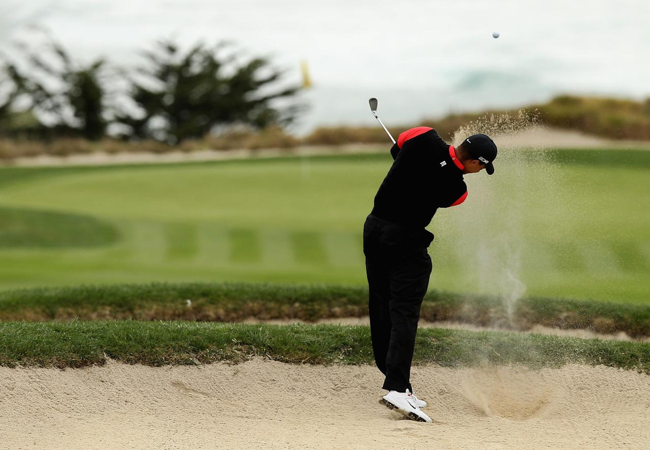 PEBBLE BEACH, CA - FEBRUARY 12: Tiger Woods hits out of a bunker on the tenth hole during the final round of the AT&T Pebble Beach National Pro-Am at Pebble Beach Golf Links on February 12, 2012 in Pebble Beach, California.  (Photo by Ezra Shaw/Getty Images)