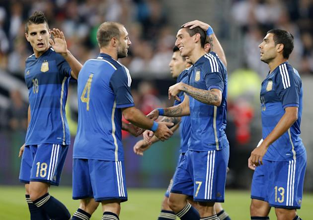 Argentina's players celebrate their side's fourth goal by Angel Di Maria, 2nd right, during the friendly soccer match between Germany and Argentina in Duesseldorf, Germany, Wednesday, Sept. 3, 2014. (AP Photo/Frank Augstein)