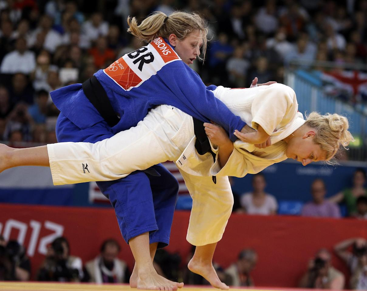 Kayla Harrison of the United States (in white) competes against Gemma Gibbons of Great Britain for the gold medal during the women's 78-kg judo competition at the 2012 Summer Olympics, Thursday, Aug. 2, 2012, in London. Harrison won the gold and Gibbons won the silver. (AP Photo/Paul Sancya)