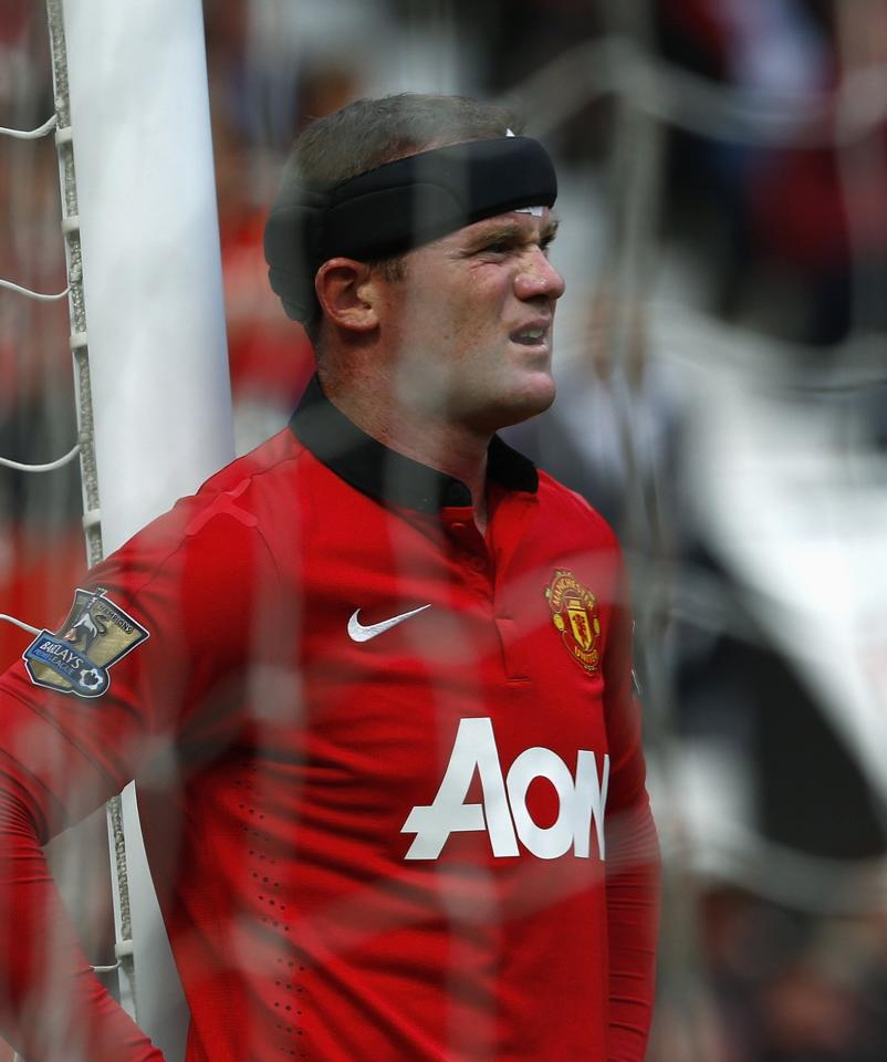 "Manchester United's Wayne Rooney reacts during their English Premier League soccer match against Crystal Palace at Old Trafford in Manchester, northern England September 14, 2013. REUTERS/Darren Staples (BRITAIN - Tags: SPORT SOCCER) FOR EDITORIAL USE ONLY. NOT FOR SALE FOR MARKETING OR ADVERTISING CAMPAIGNS. NO USE WITH UNAUTHORIZED AUDIO, VIDEO, DATA, FIXTURE LISTS, CLUB/LEAGUE LOGOS OR ""LIVE"" SERVICES. ONLINE IN-MATCH USE LIMITED TO 45 IMAGES, NO VIDEO EMULATION. NO USE IN BETTING, GAMES OR SINGLE CLUB/LEAGUE/PLAYER PUBLICATIONS"