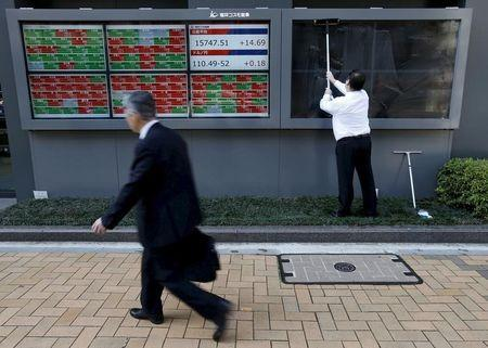 Nikkei climbs as rising yields help financials; Topix rebalance b