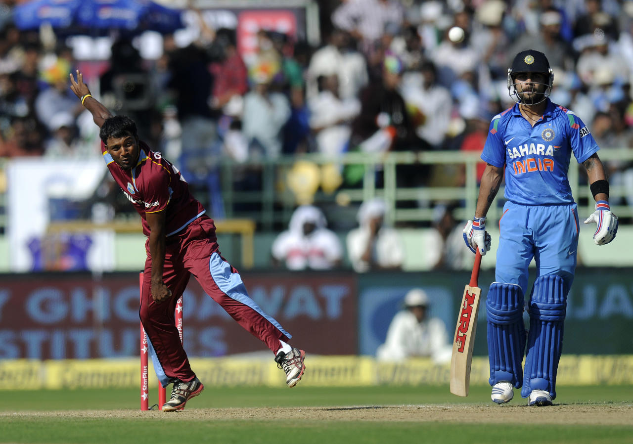 Veerasammy Permaul of West Indies bowls during the second Star Sports One Day International (ODI) match between India and The West Indies held at the Dr. Y.S. Rajasekhara Reddy ACA-VDCA Cricket Stadium, Vishakhapatnam, India on the 24th November 2013  Photo by: Pal Pillai - BCCI - SPORTZPICS   Use of this image is subject to the terms and conditions as outlined by the BCCI. These terms can be found by following this link:  http://sportzpics.photoshelter.com/gallery/BCCI-Image-Terms/G0000ahUVIIEBQ84/C0000whs75.ajndY