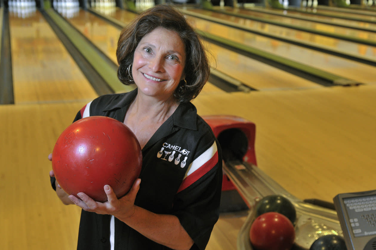"Owner Peppe Smith stands in her bowling alley in Boardman, Ohio. Smith sees positive signs all around her suburban Youngstown community. ""I cannot deny that I am better off than I was four years ago,"" she declares, then pointedly adds: ""I do not attribute that to the president."""