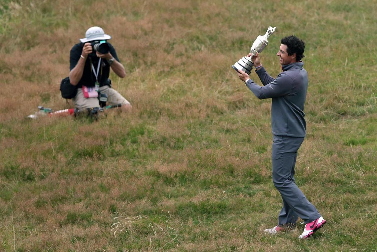 Rory McIlroy of Northern Ireland is photographed as he holds the Claret Jug trophy after winning the British Open Golf championship at the Royal Liverpool golf club, Hoylake, England, Sunday July 20, 2014. (AP Photo/Jon Super)