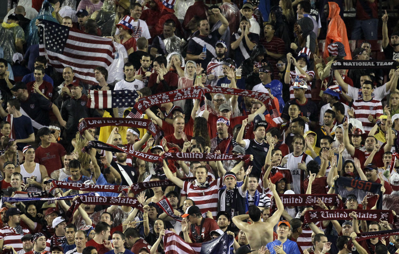 U.S. soccer fans celebrate their team's 3-1 win over Antigua and Barbuda during a FIFA World Cup qualifying soccer match Friday, June 8, 2012, in Tampa, Fla. (AP Photo/Chris O'Meara)
