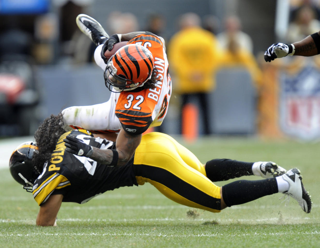 Pittsburgh Steelers strong safety Troy Polamalu (43) upends Cincinnati Bengals running back Cedric Benson (32) in the first quarter of an NFL football game in Pittsburgh on Sunday, Dec. 4, 2011. (AP Photo/Don Wright)