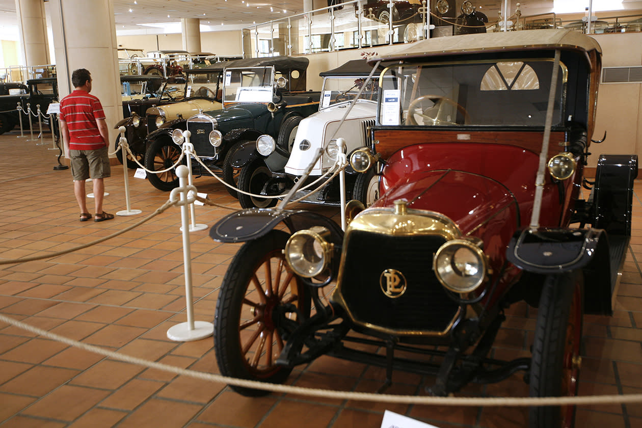 A visitor looks at the cars of the collection of Prince Albert II of Monaco at the Automobile Museum in Monaco.