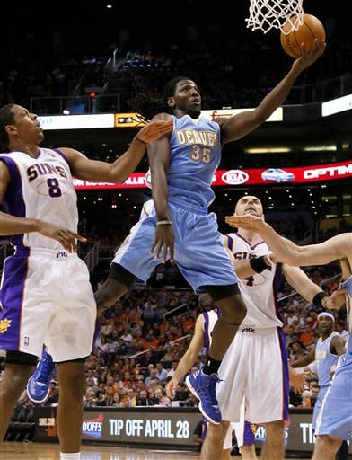 Denver Nuggets' Kenneth Faried (35) drives past Phoenix Suns' Channing Frye (8) during the first half of an NBA basketball game on Saturday, April 21, 2012, in Phoenix. (AP Photo/Matt York)