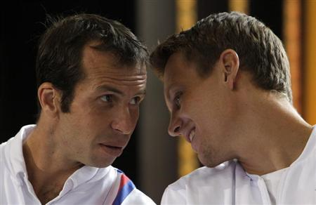 Czech Republic's Radek Stepanek and Tomas Berdych chat during the draw for the Davis Cup semifinals in Prague