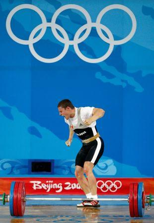 Alexandru Dudoglo of Moldova reacts after lifting 172kg in the men's 69kg Group B clean and jerk weightlifting competition at the Beijing 2008 Olympic Games August 12, 2008.     REUTERS/Yves Herman
