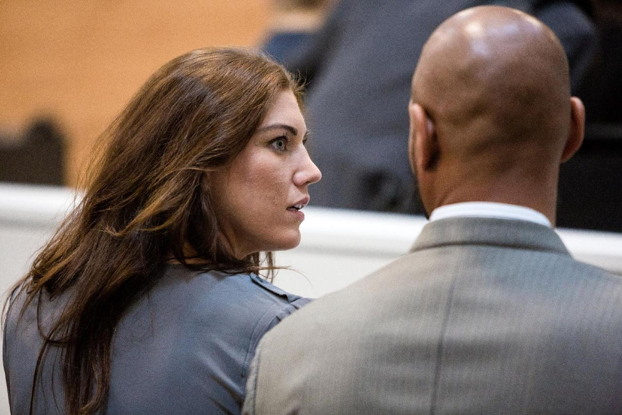 U.S. soccer player Hope Solo, left, appears alongside her husband, former Seahawks tight end Jerramy Stevens in Kirkland Municipal Court in Kirkland, Wash., Monday, Aug. 11, 2014. (AP Photo/seattlepi.com, Jordan Stead) NO SALES; MAGS OUT; SEATTLE TIMES OUT MAGS OUT; MANDATORY CREDIT; TV OUT