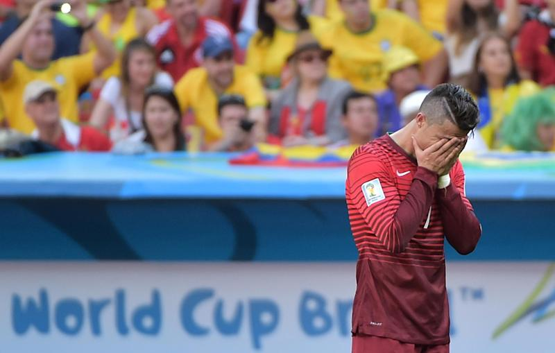 Cristiano Ronaldo reacts after Portugal were booted out of the World Cup despite winning against Ghana at the Mane Garrincha National Stadium in Brasilia on June 26, 2014