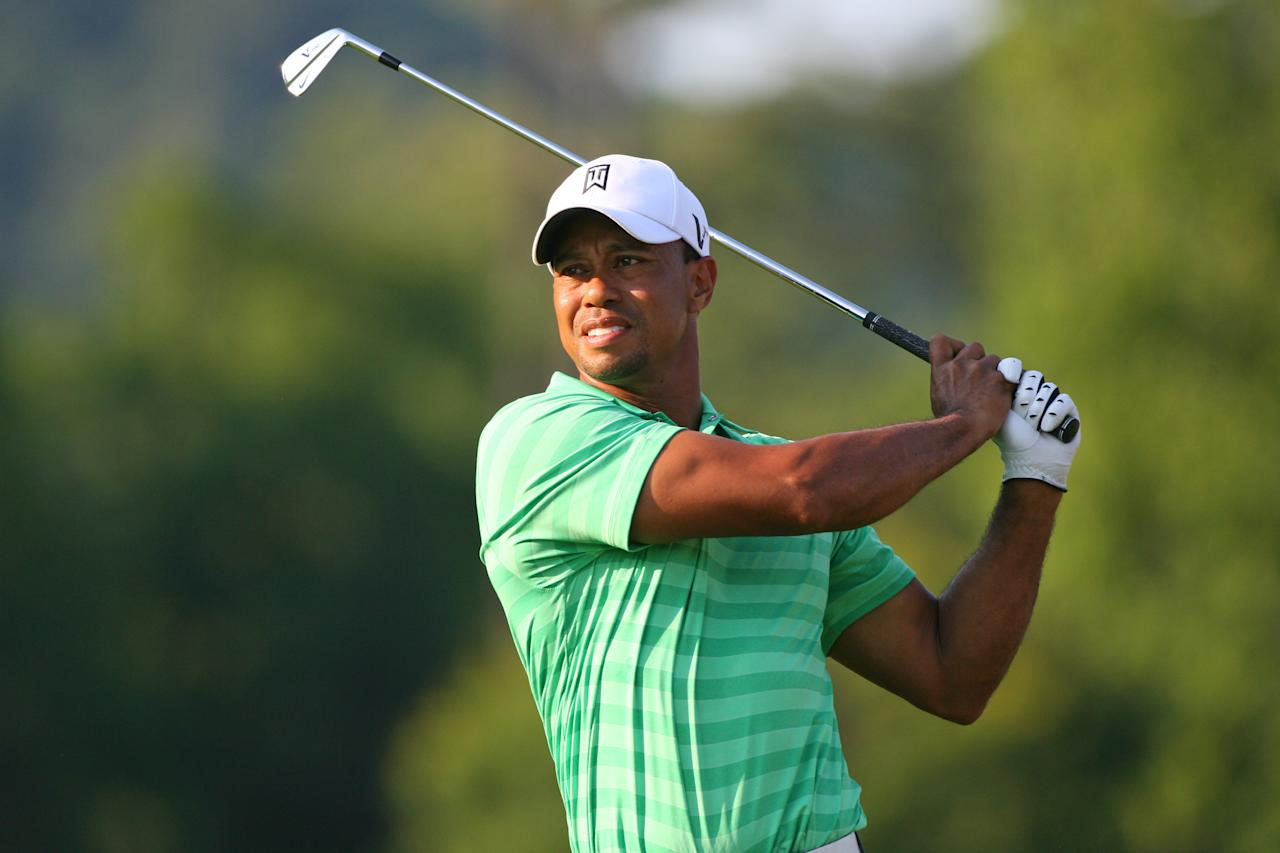 WHITE SULPHUR SPRINGS, WV - JULY 6: Tiger Woods hits his second shot on the 12th hole during the second round of the Greenbrier Classic at the Old White TPC on July 6, 2012 in White Sulphur Springs, West Virginia. (Photo by Hunter Martin/Getty Images)
