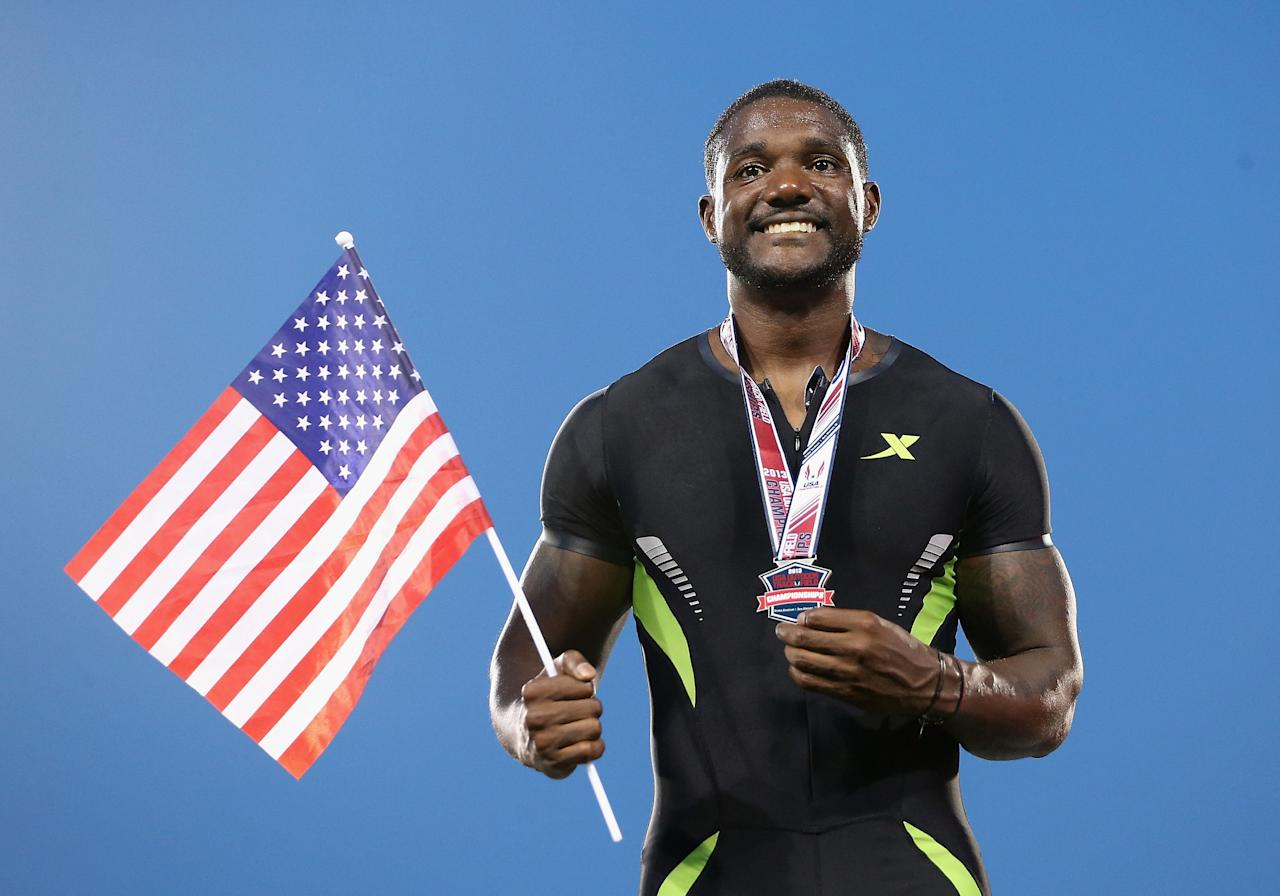 DES MOINES, IA - JUNE 21: Justin Gatlin poses on the podium after finishing the Men's 100 Meter Dash final in second place on day two of the 2013 USA Outdoor Track & Field Championships at Drake Stadium on June 21, 2013 in Des Moines, Iowa. (Photo by Christian Petersen/Getty Images)