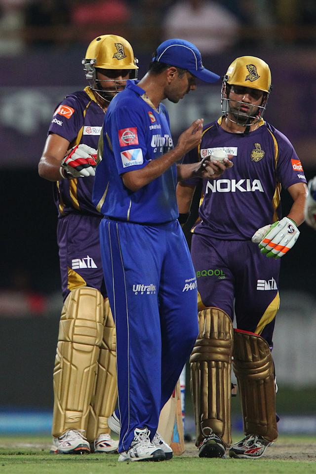 Manvinder Bisla, Rahul Dravid and Gautam Gambhir inspect the ball during match 47 of the Pepsi Indian Premier League between The Kolkata Knight Riders and the Rajasthan Royals held at the Eden Gardens Stadium in Kolkata on the 3rd May 2013..Photo by Ron Gaunt-IPL-SPORTZPICS  ..Use of this image is subject to the terms and conditions as outlined by the BCCI. These terms can be found by following this link:..http://www.sportzpics.co.za/image/I0000SoRagM2cIEc