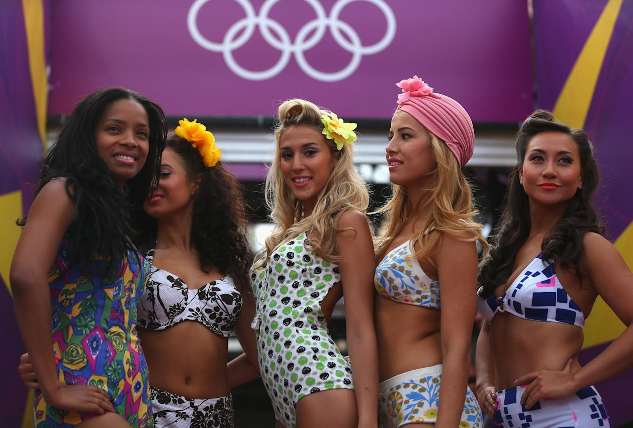 LONDON, ENGLAND - JULY 28:  Cheerleaders perform during Women's Beach Volleyball on Day 1 of the London 2012 Olympic Games at Horse Guards Parade on July 28, 2012 in London, England.  (Photo by Alexander Hassenstein/Getty Images)
