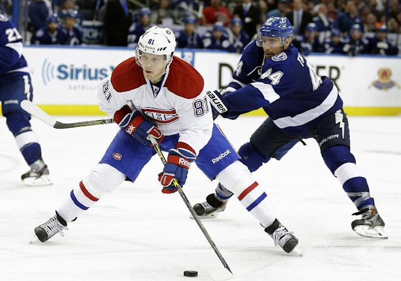 Montreal Canadiens center Lars Eller (81), of Denmark, cuts around Tampa Bay Lightning center Nate Thompson (44) just before scoring during the third period of Game 1 of a first-round NHL hockey playoff series on Wednesday, April 16, 2014, in Tampa, Fla