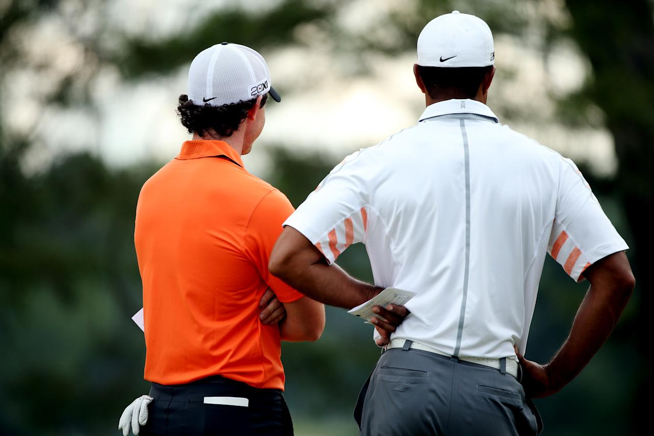 ARDMORE, PA - JUNE 14: Rory McIlroy of Northern Ireland and Tiger Woods of the United States stand on a green during Round Two of the 113th U.S. Open at Merion Golf Club on June 14, 2013 in Ardmore, Pennsylvania. (Photo by Andrew Redington/Getty Images)