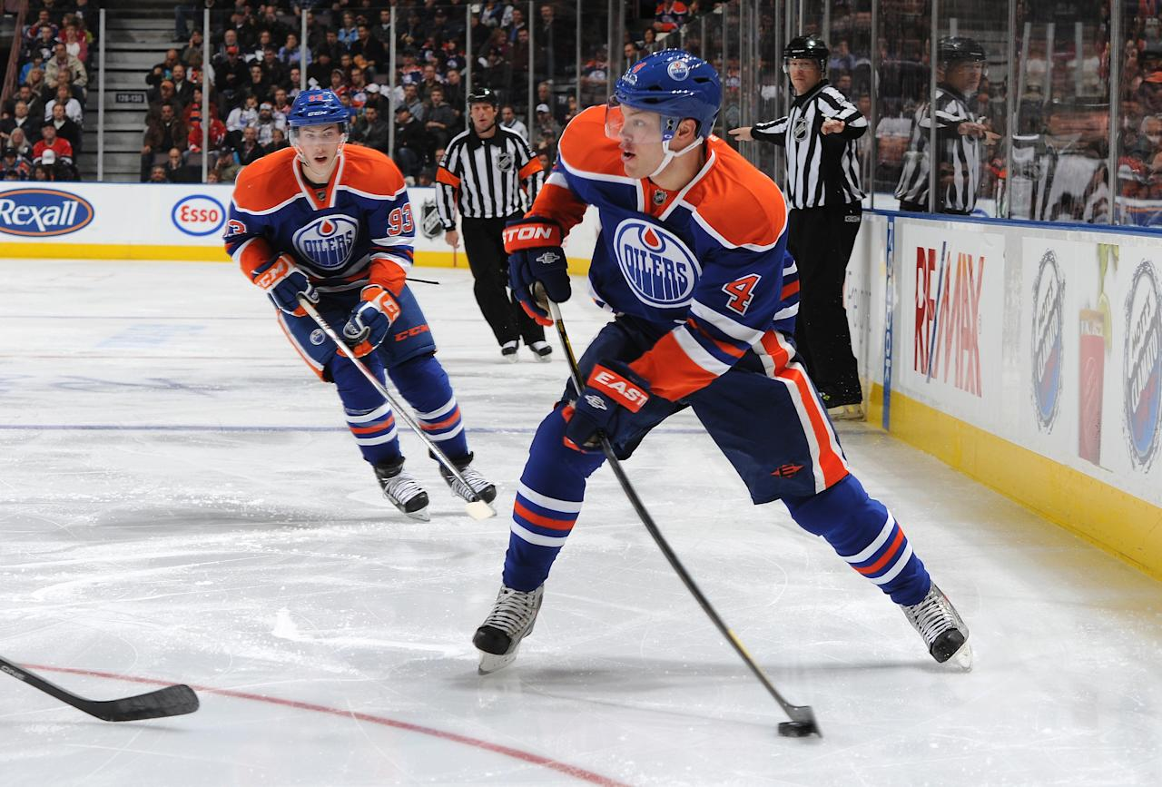 EDMONTON, CANADA - NOVEMBER 19: Taylor Hall #4 and Ryan Nugent-Hopkins #93 of the Edmonton Oilers break down the ice against the Chicago Blackhawks on November 19, 2011 at Rexall Place in Edmonton, Alberta, Canada. (Photo by Dale MacMillan/Getty Images)