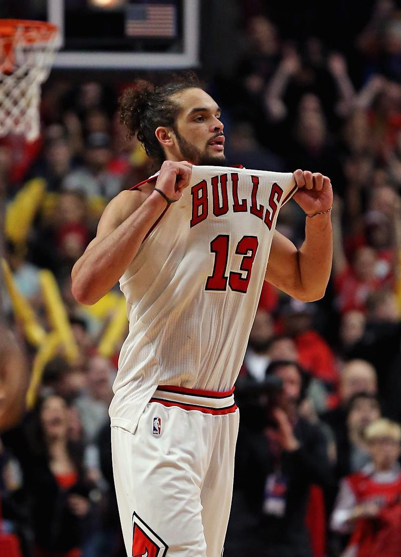Noah, Augustin lead Bulls over Heat 95-88 in OT