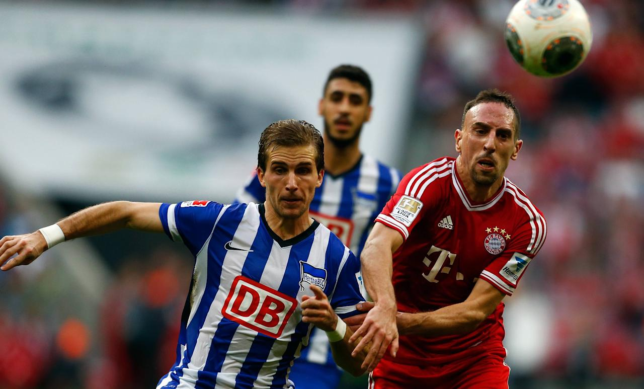 Franck Ribery of FC Bayern Munich is challenged by Hertha Berlin's Peter Pekarik during their German first division Bundesliga soccer match in Munich October 26, 2013. REUTERS/Michael Dalder (GERMANY - Tags: SPORT SOCCER) DFL RULES TO LIMIT THE ONLINE USAGE DURING MATCH TIME TO 15 PICTURES PER GAME. IMAGE SEQUENCES TO SIMULATE VIDEO IS NOT ALLOWED AT ANY TIME. FOR FURTHER QUERIES PLEASE CONTACT DFL DIRECTLY AT + 49 69 650050