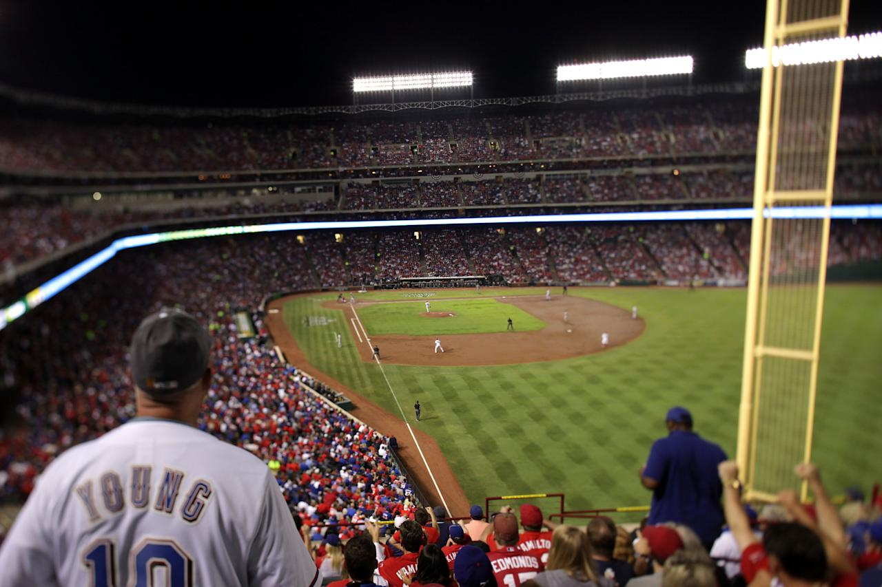 ARLINGTON, TX - OCTOBER 23: (EDITORS NOTE: Image was created using a variable planed lens.) Fans watch the action between the St. Louis Cardinals and the Texas Rangers during Game Four of the MLB World Series at Rangers Ballpark in Arlington on October 23, 2011 in Arlington, Texas.  (Photo by Rob Carr/Getty Images)