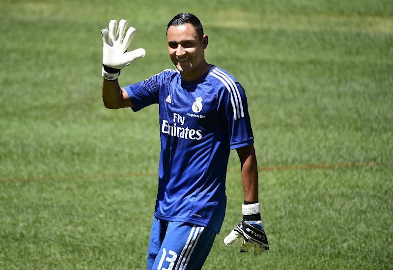 Costa Rican goalkeeper Keylor Navas poses before a press conference for his official presentation following his signing with Spanish club Real Madrid in Madrid on August 5, 2014