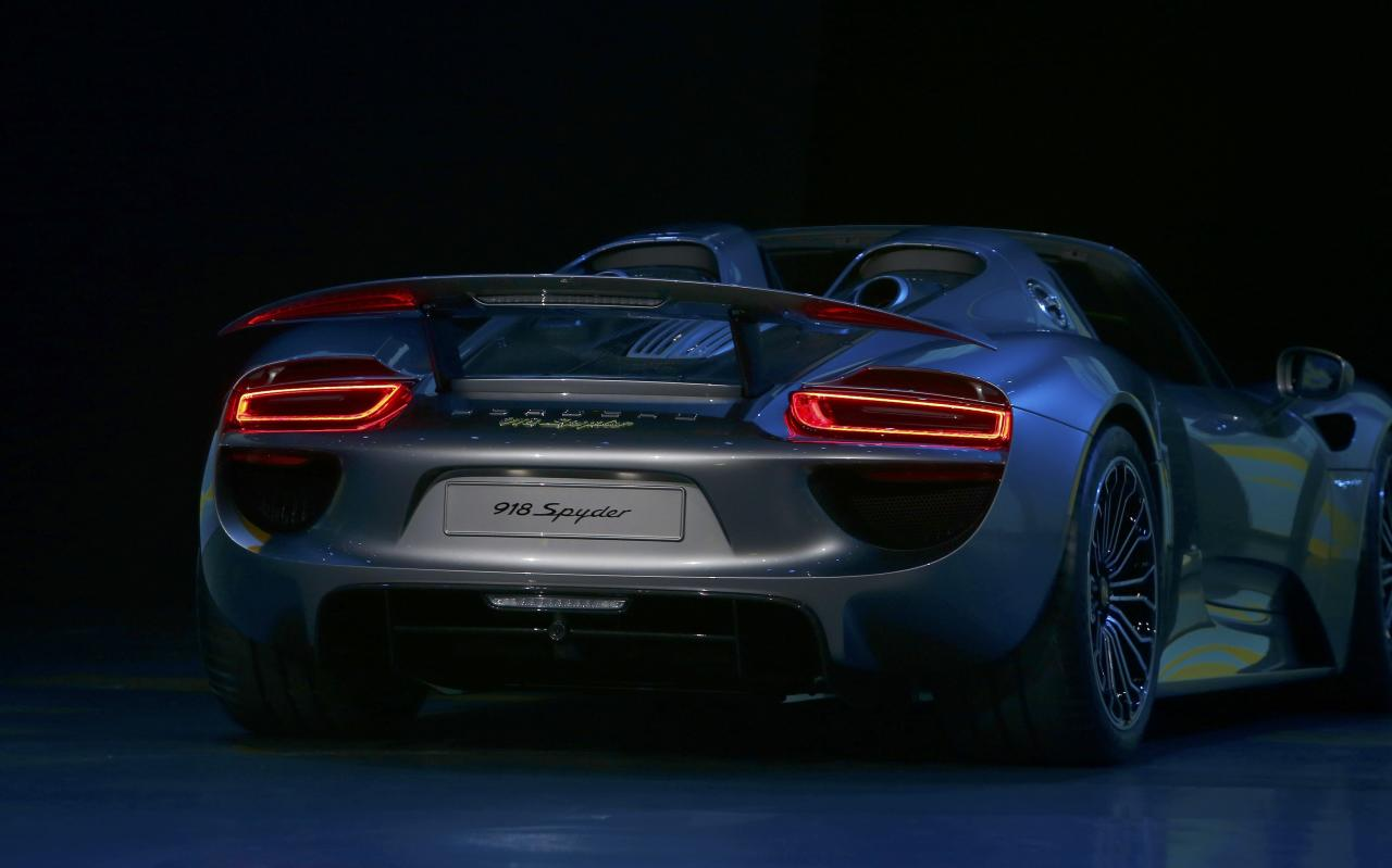 The new Porsche 918 Spyder hybrid car is presented at the Volkswagen group night at the Frankfurt motor show September 9, 2013. The world's biggest auto show is open to the public September 14 -22. REUTERS/Ralph Orlowski (GERMANY - Tags: BUSINESS TRANSPORT)