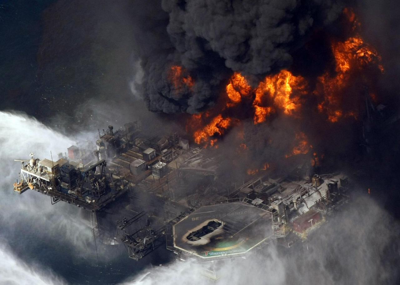 "FILE - In this April 21, 2010 file aerial photo taken in the Gulf of Mexico more than 50 miles southeast of Venice on Louisiana's tip, the Deepwater Horizon oil rig is seen burning. New research shows that the BP oil spill left an oily ""bathub ring"" on the seafloor that's about the size of Rhode Island. The study by David Valentine, the chief scientist on the federal damage assessment research ships, estimates that about 10 million gallons of oil coagulated on the floor of the Gulf of Mexico around the damaged Deepwater Horizons oil rig. Valentine said the spill left even bigger deeper oil splotches besides the ring. The rig blew on April 20, 2010 and spewed 172 million gallons of oil into the Gulf through the summer. Scientists are still trying to figure where all the oil went and what it did to the Gulf. (AP Photo/Gerald Herbert, File)"