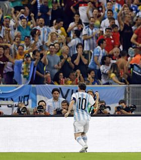 Lionel Messi pumps his first in jubilation as Argentina fans cheer him on. (AP)