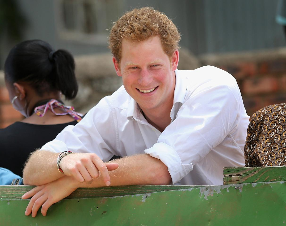 MASERU, LESOTHO - FEBRUARY 27:  Prince Harry smiles during a visit to St Bernadette's Centre for the blind, a project supported by his charity Sentebale on February 27, 2013 in Maseru, Lesotho. Sentebale is a charity founded by Prince Harry and Prince Seeiso of Lesotho. It helps the most vulnerable children in Lesotho get the support they need to lead healthy and productive lives. Sentebale works with local grassroots organisations to help these children, the victims of extreme poverty and Lesotho's HIV/AIDS epidemic. Cathy Ferrier was appointed as Sentebale's Chief Executive in March 2012 and is spearheading a fundraising initiative to build the Mamohato Centre which will provide psychosocial support for children and young people infected with HIV. Prince Harry is due to pay a visit to Lesotho this week to catch up on his charity's progress and meet key children who will be supported by the charity.  (Photo by Chris Jackson/Getty Images)