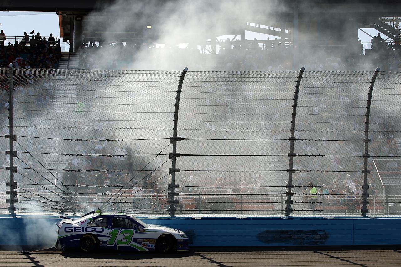 AVONDALE, AZ - MARCH 04:  Casey Mears, driver of the #13 GEICO Ford, crashes into the wall during the NASCAR Sprint Cup Series SUBWAY Fresh Fit 500 at Phoenix International Raceway on March 4, 2012 in Avondale, Arizona.  (Photo by Christian Petersen/Getty Images)