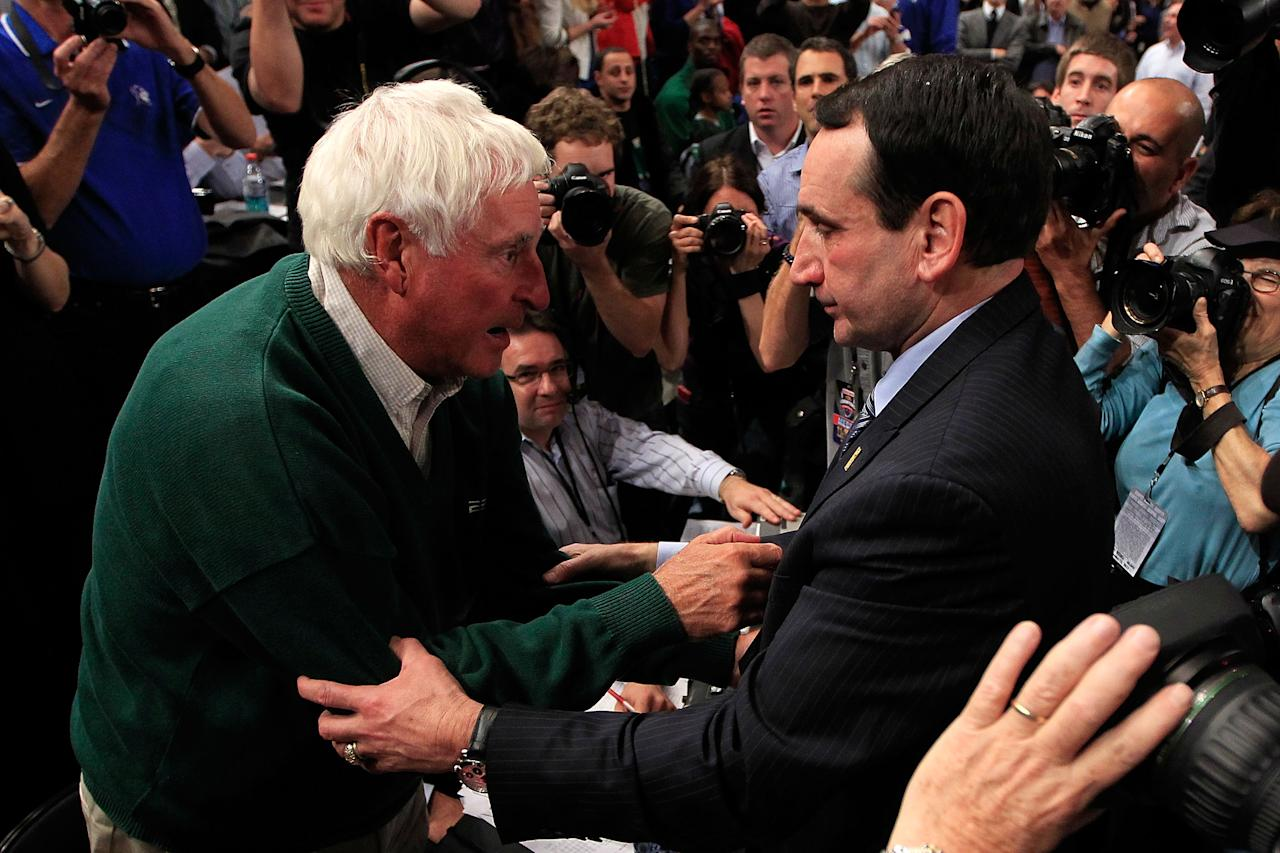 NEW YORK - NOVEMBER 15: (R) Head coach Mike Krzyzewski of the Duke Blue Devils embraces (L) Bobby Knight after winning his 903 NCAA Division 1 basketball game and becoming the winningest coach in history taking the record from Bobby Knight after defeating the Michigan State Spartans during the 2011 State Farms Champions Classic at Madison Square Garden on November 15, 2011 in New York City.  (Photo by Chris Trotman/Getty Images)
