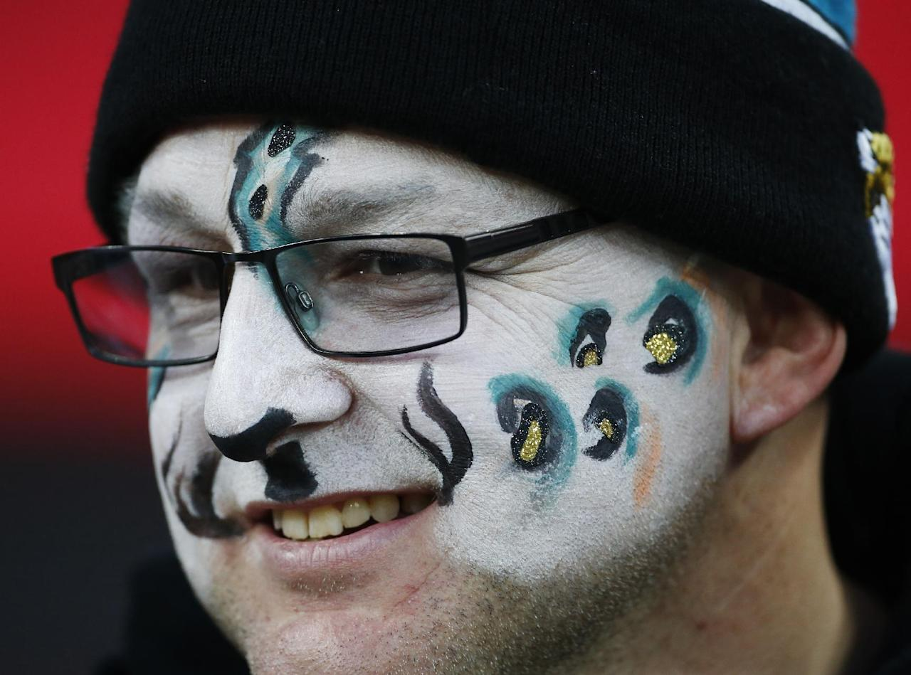 A Jacksonville Jaguars waits for the start of the NFL football game between the San Francisco 49ers and the Jacksonville Jaguars at Wembley Stadium, London, Sunday, Oct. 27, 2013.  (AP Photo/Matt Dunham)