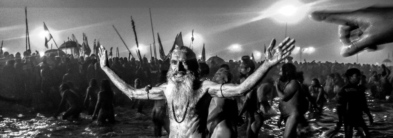 ALLAHABAD, INDIA - JANUARY 14: (EDITORS NOTE: Image was created using the iPhone panoramic application) Naga sadhus bathe in the waters of Sangam during the auspicious bathing day of Makar Sankranti of the Maha Kumbh Mela on January 14, 2013 in Allahabad, India. The Maha Kumbh Mela, believed to be the largest religious gathering on earth is held every 12 years on the banks of Sangam, the confluence of the holy rivers Ganga, Yamuna and the mythical Saraswati. The Kumbh Mela alternates between the cities of Nasik, Allahabad, Ujjain and Haridwar every three years. The Maha Kumbh Mela celebrated at the holy site of Sangam in Allahabad, is the largest and holiest, celebrated over 55 days, it is expected to attract over 100 million people. (Photo by Daniel Berehulak/Getty Images)
