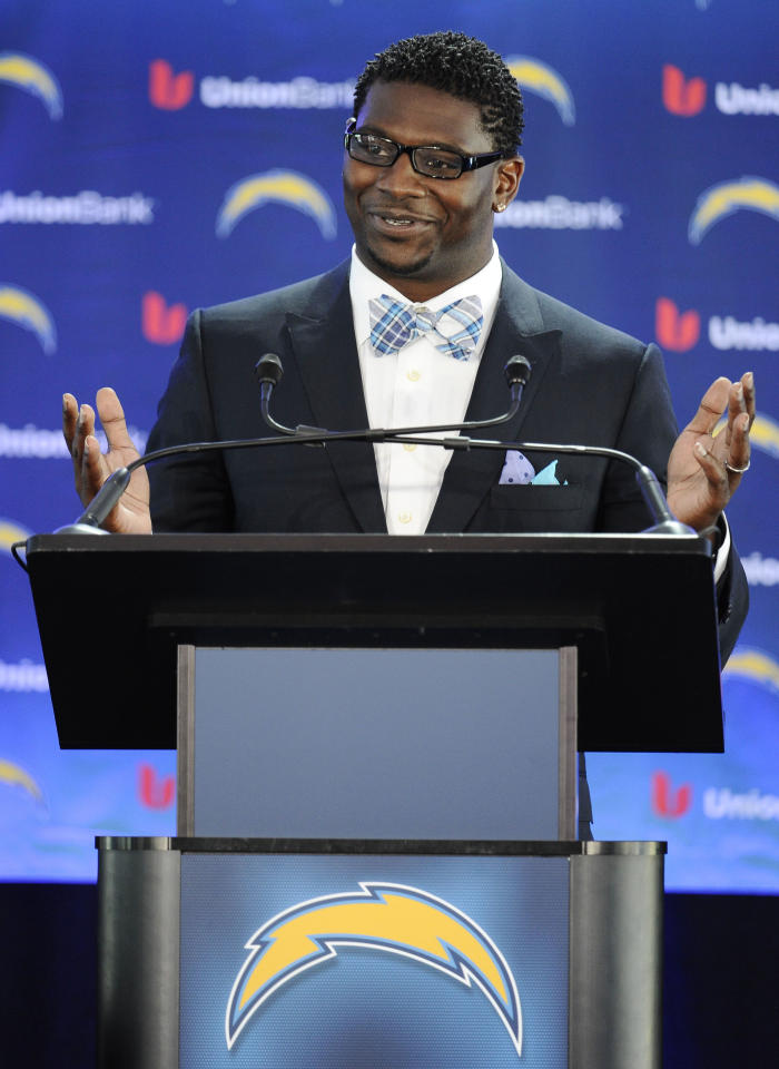Former San Diego Chargers running back LaDainian Tomlinson speaks at a news conference held at the San Diego Chargers facility Monday, June 18, 2012 in San Diego. Tomlinson signed a one-day contract with the Chargers and announced his retirement. (AP Photo/Denis Poroy)