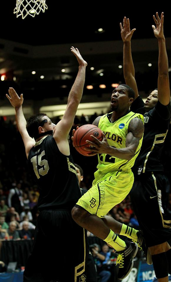 ALBUQUERQUE, NM - MARCH 17:  A.J. Walton #22 of the Baylor Bears shoots against Shane Harris-Tunks #15 and Andre Roberson #21 of the Colorado Buffaloes in the first half during the third round of the 2012 NCAA Men's Basketball Tournament at The Pit on March 17, 2012 in Albuquerque, New Mexico.  (Photo by Ronald Martinez/Getty Images)
