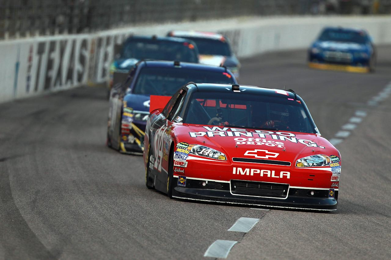 FORT WORTH, TX - NOVEMBER 06:  Tony Stewart, driver of the #14 Office Depot/Mobil 1 Chevrolet, leads a pack of cars during the NASCAR Sprint Cup Series AAA Texas 500 at Texas Motor Speedway on November 6, 2011 in Fort Worth, Texas.  (Photo by Ronald Martinez/Getty Images)